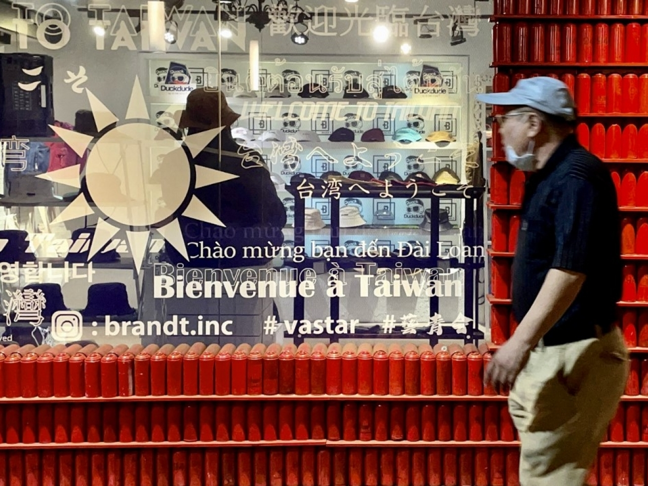Shops selling non-essential items could be ordered to close in Taiwan as the number of Covid infections rises. File photo: AFP