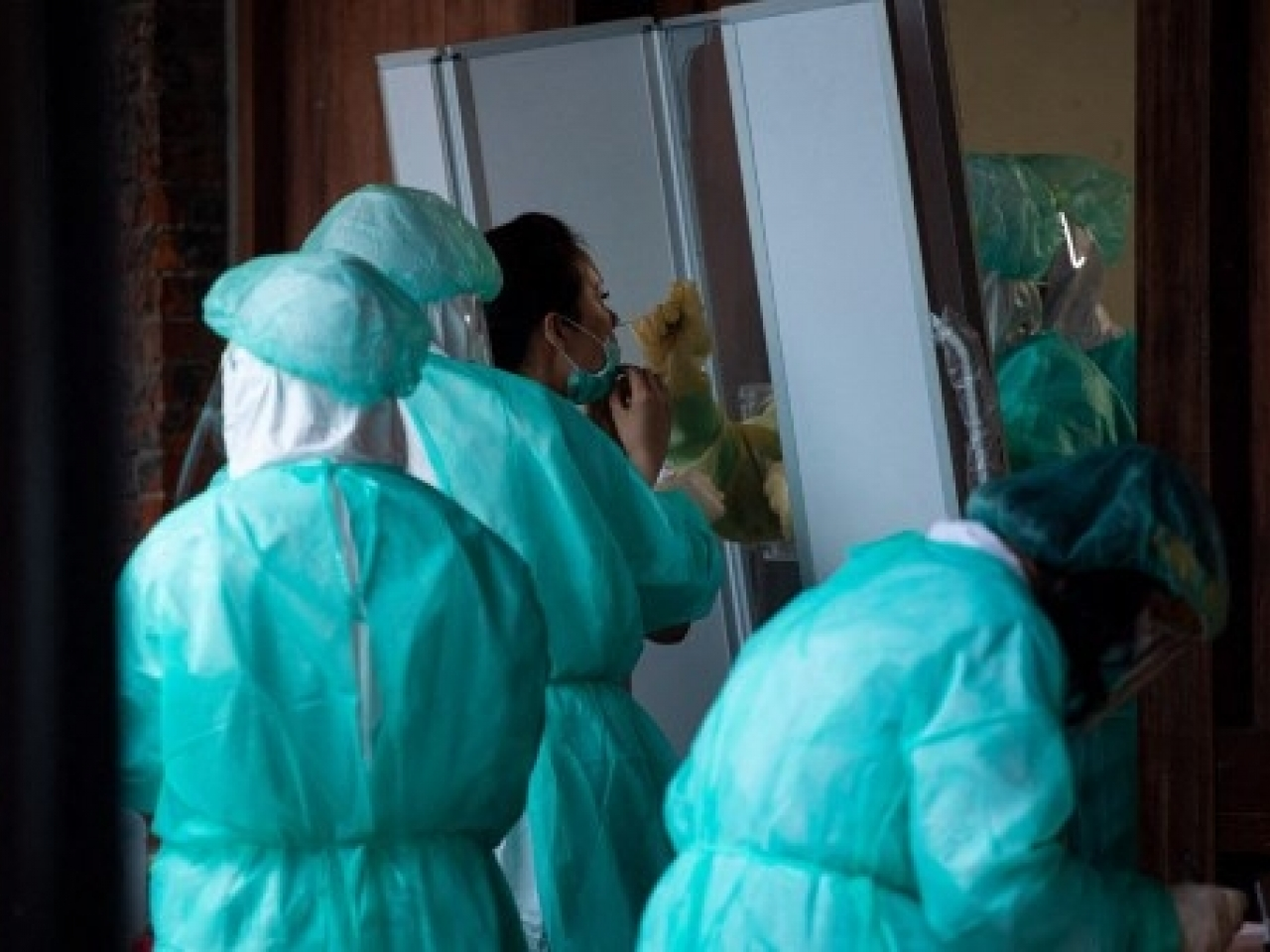A woman seen getting the rapid Covid-19 test in Wanhua District following the outbreak in Taipei. Photo: AFP