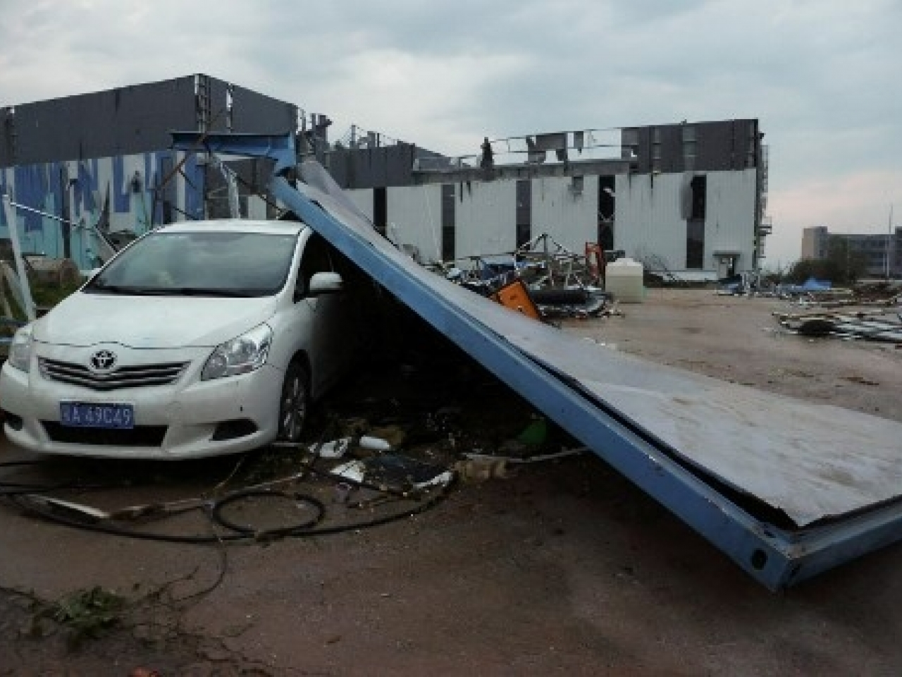 Damaged cars and buildings after a tornado hit an economic zone in Wuhan. Photo: AFP