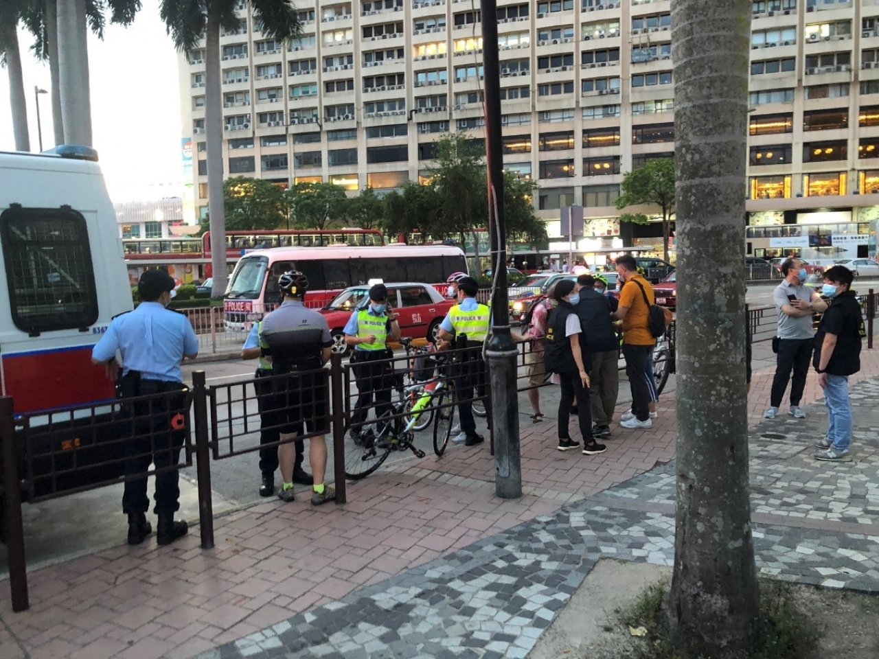 One group of cyclists is stopped by police officers near the start of the 'Ride of Silence' route near Tsim Sha Tsui. Photo supplied by Transit Jam