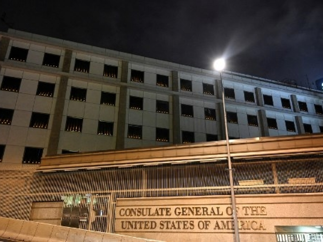 Scores of candles were seen lit in the windows of the US consulate building on Friday night. Photo: AFP