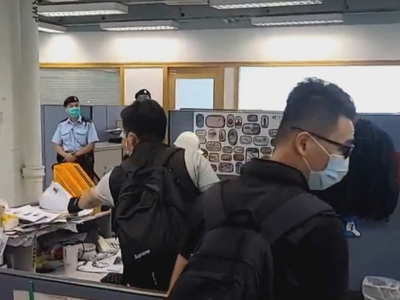 Police officers conducting a search at Apple Daily's offices in August last year.