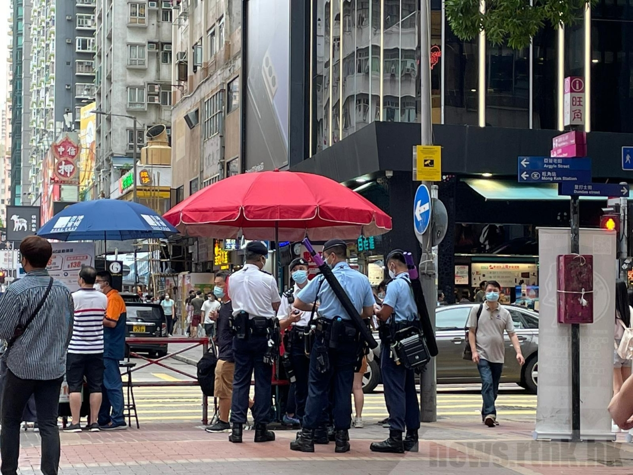 Police officers are seen patrolling the streets of Mong Kok. Photo: RTHK