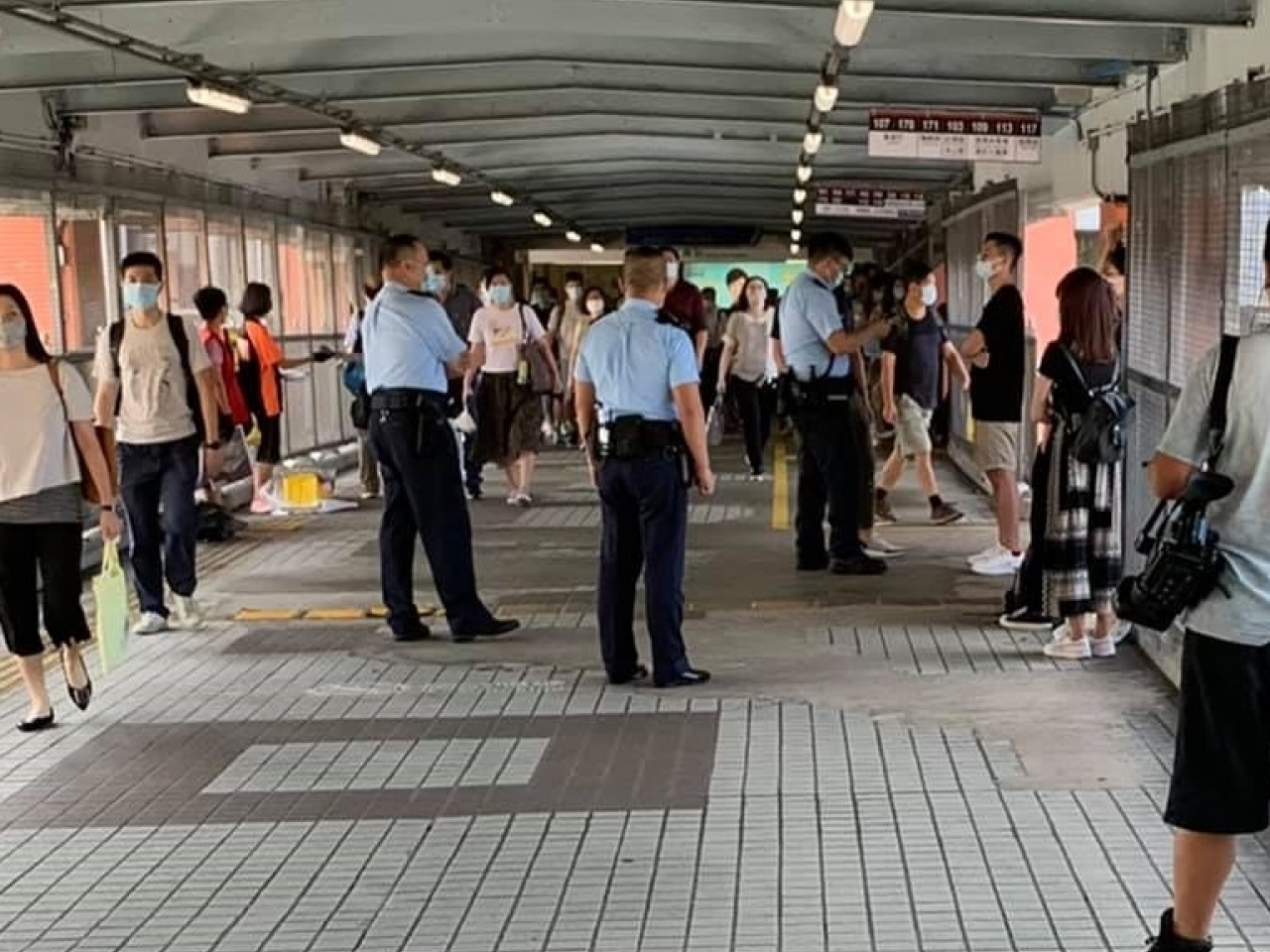 A photo shared by the activists group on their social media page shows police officers approaching them near Hung Hom MTR station.