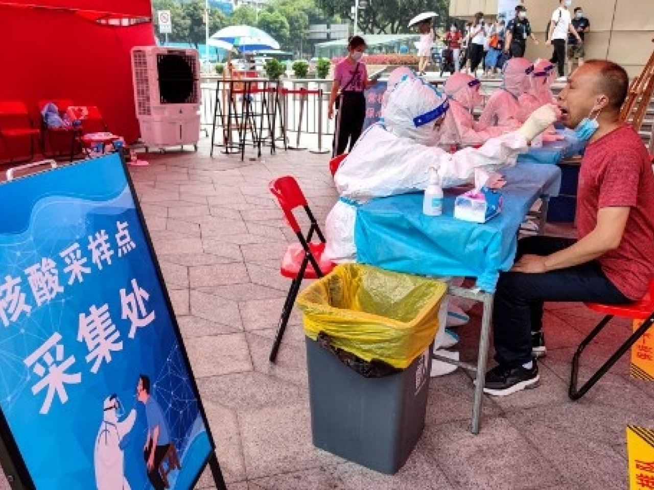 People receive nucleic acid tests for the Covid-19 coronavirus in Shenzhen. File photo: AFP