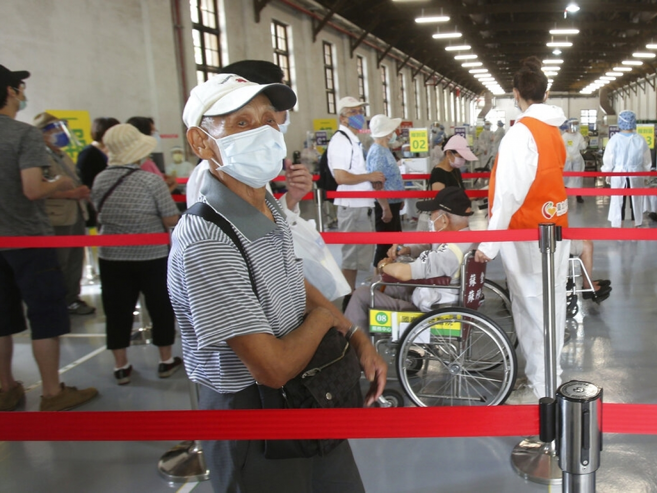 Elderly people queue for limited supplies of Covid-19 vaccinations in Taipei on Wednesday. File photo: AP