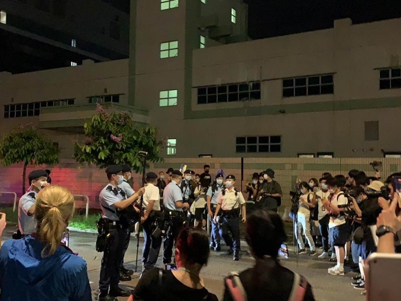 Earlier, police turned at Next Digital's headquarters in Tseung Kwan O carrying warning flags. Photo: RTHK