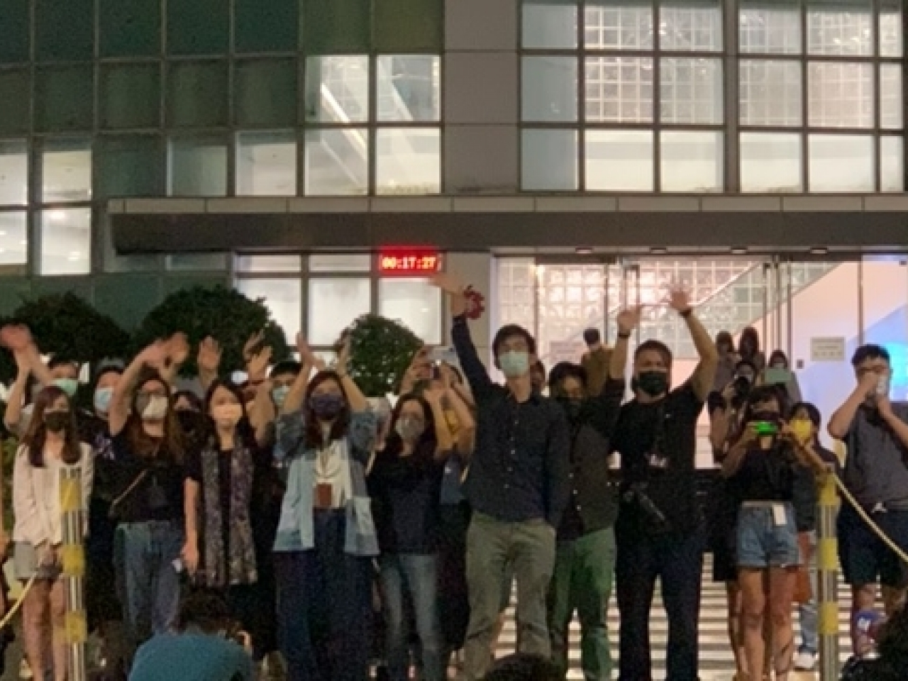 A group of Apple Daily workers went to gate of their headquarters in Tseung Kwan O to thank their supporters. Photo: RTHK