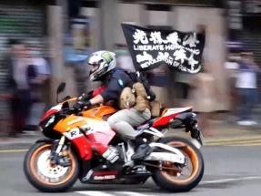 Police fired pepper shots at biker, court told