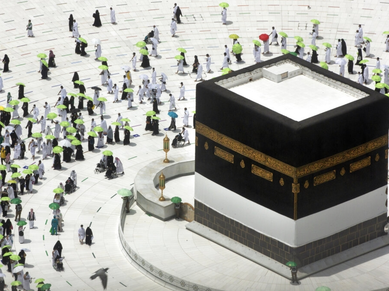 Muslim pilgrims circumambulate the Kaaba, the cubic building at the Grand Mosque, as they wear masks and keep social distancing. Photo: AP