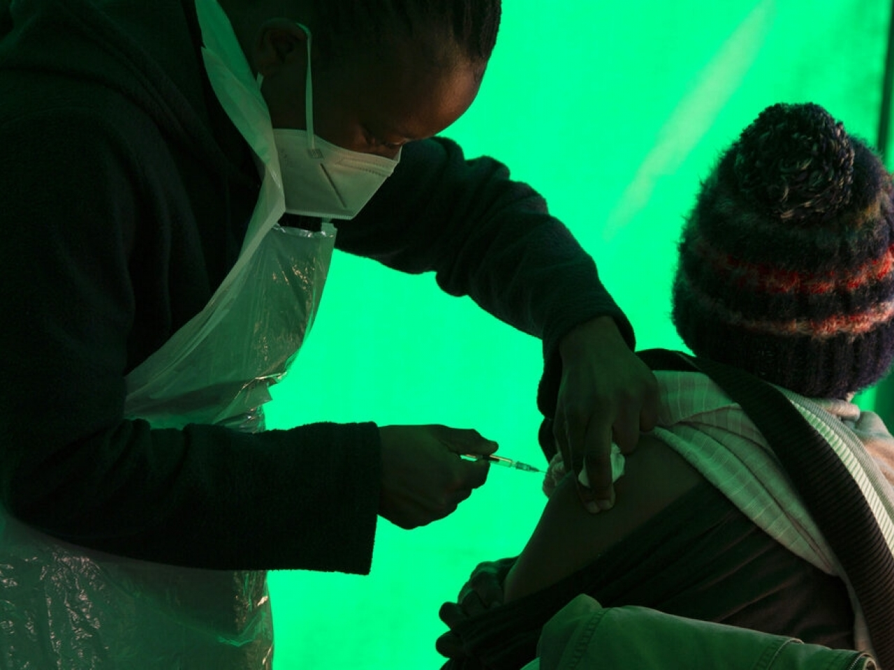 A nurse in South Africa delivers a dose of the Pfizer-BioNTech vaccine to an elderly patient. File photo: AP