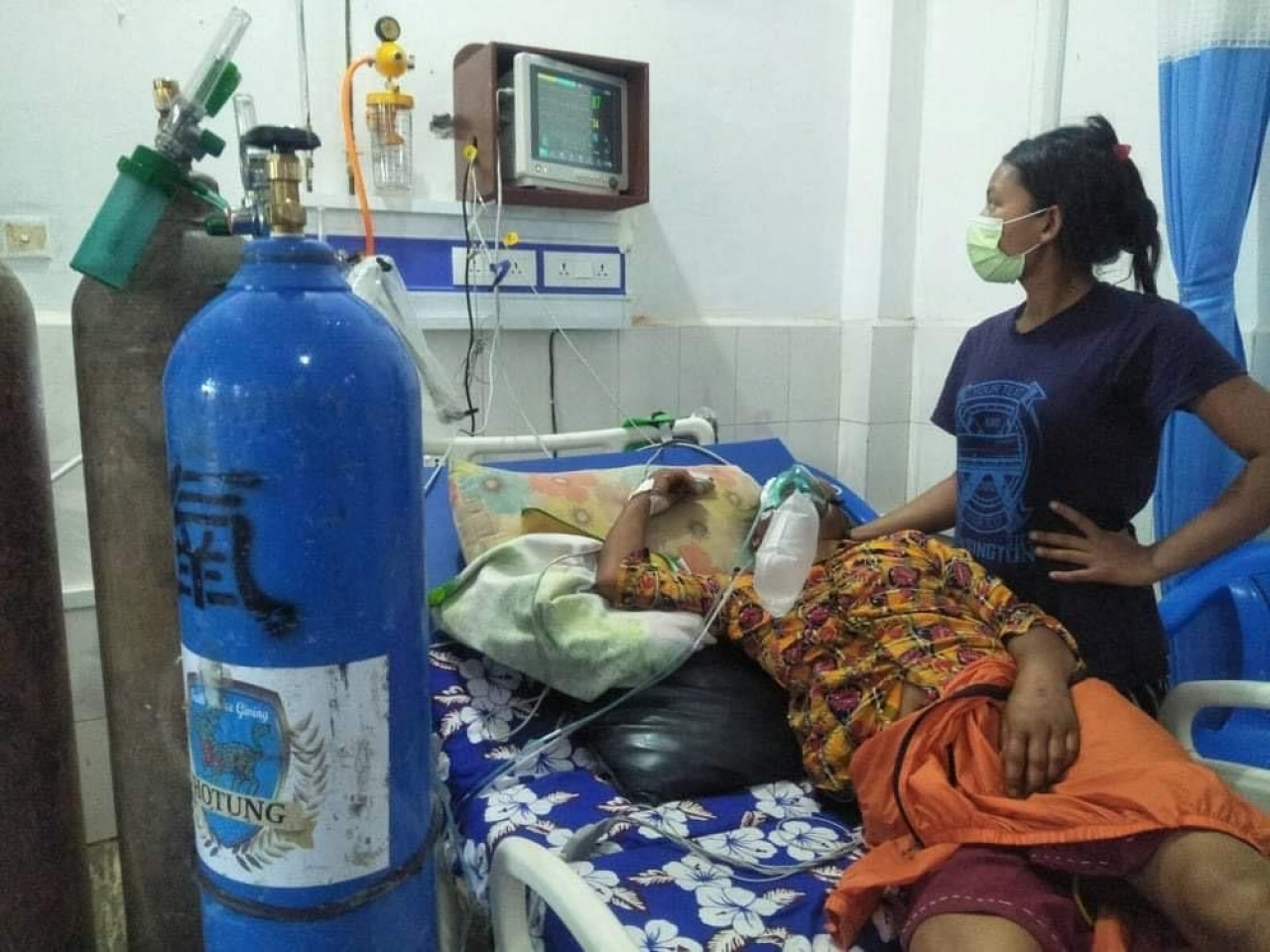 A patient in remote Karnali province is given oxygen.  The cylinder was donated by a Hong Kong initiative. Photo: submitted