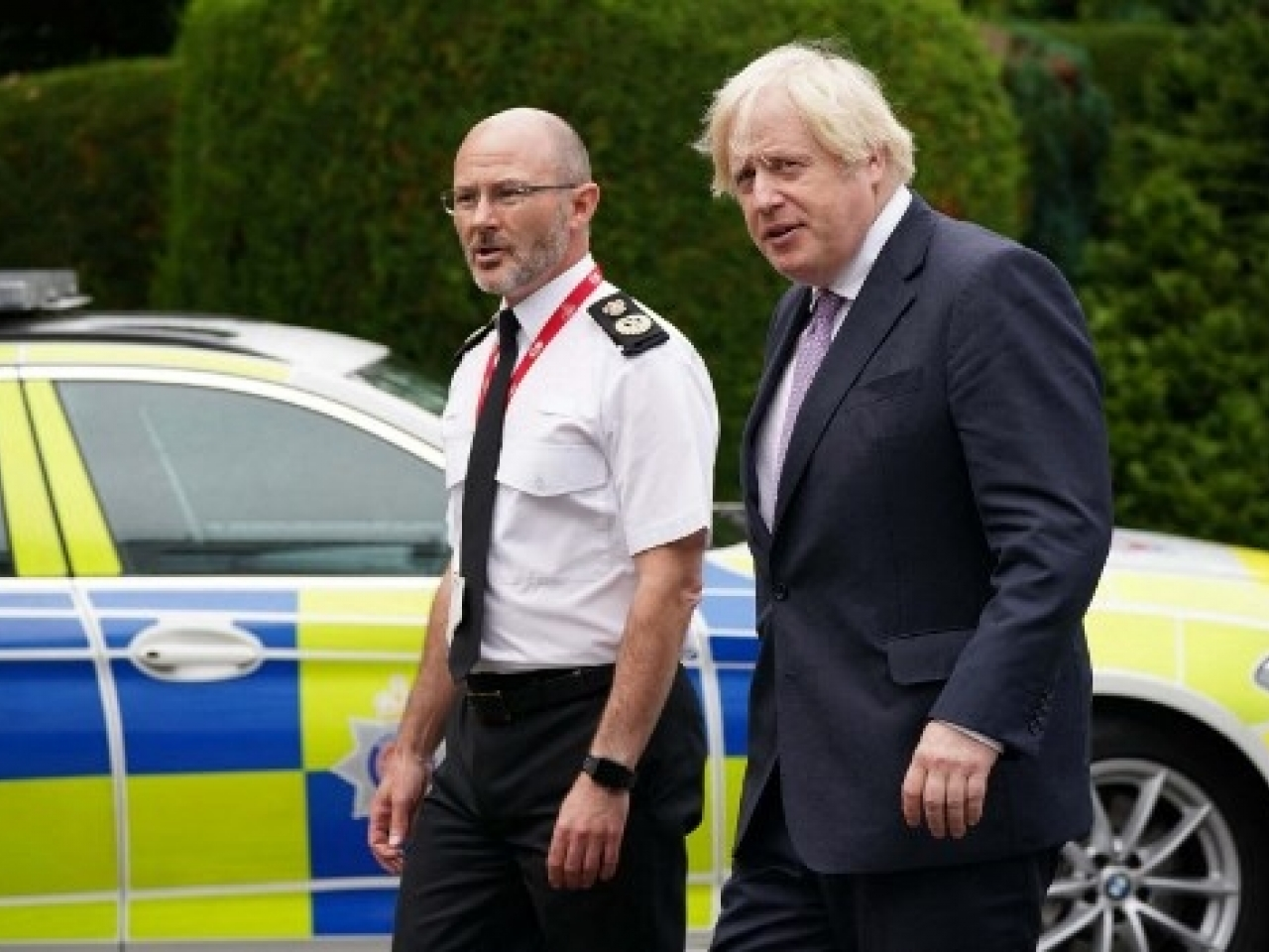 The UK prime minister (right) said people have got to remain cautious and that remained the approach of the government. Photo: AFP