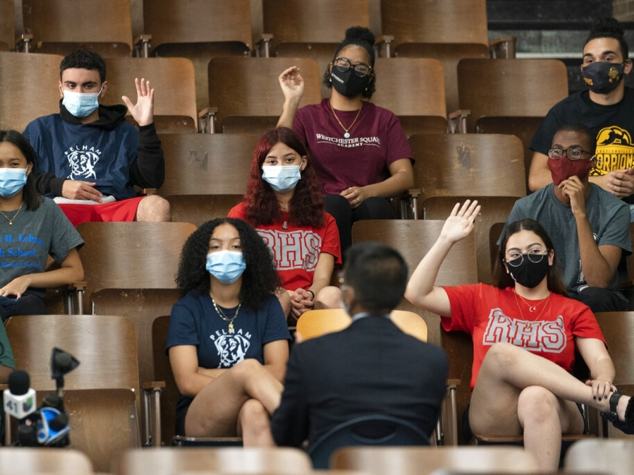 Pupils at a school in New York don masks for a discussion about Covid-19. Photo: AP