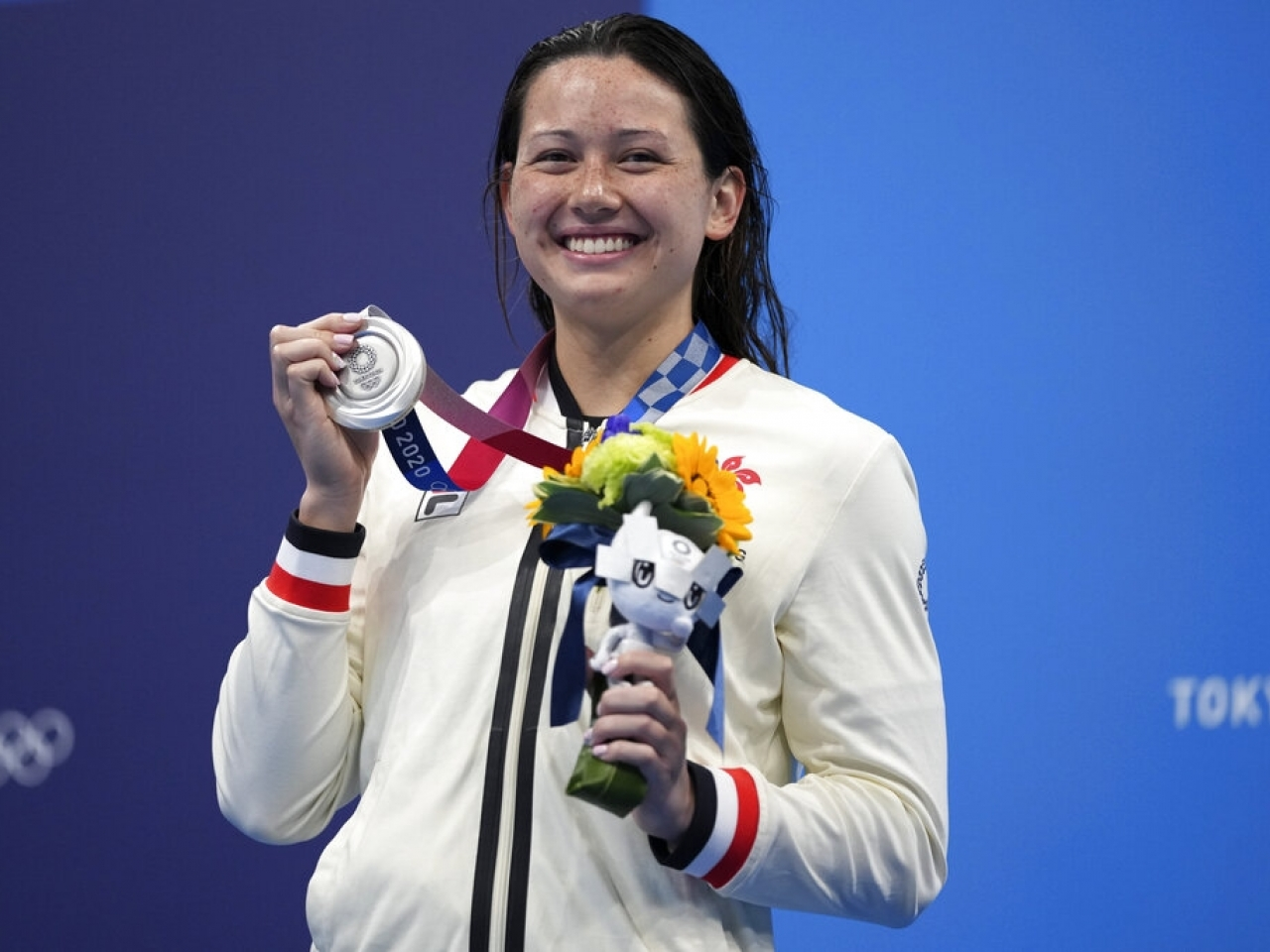 Siobhan Haughey proudly shows off Hong Kong's first ever medal in Olympic swimming. Photo: AP