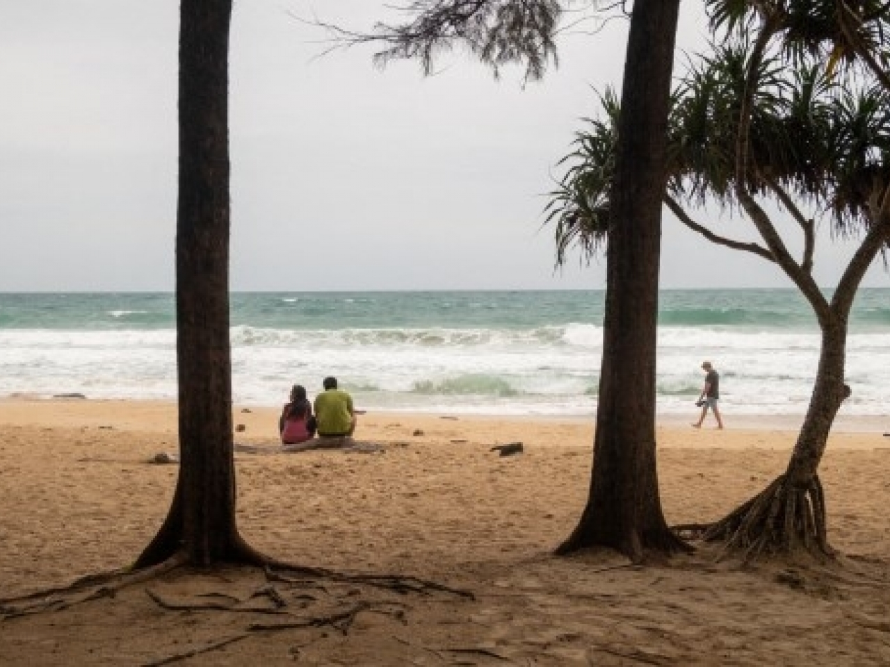 Travellers sit on a sparsely populated beach on Phuket earlier this month. The Thai holiday island has opened up quarantine-free travel to vaccinated tourists. File photo: AFP
