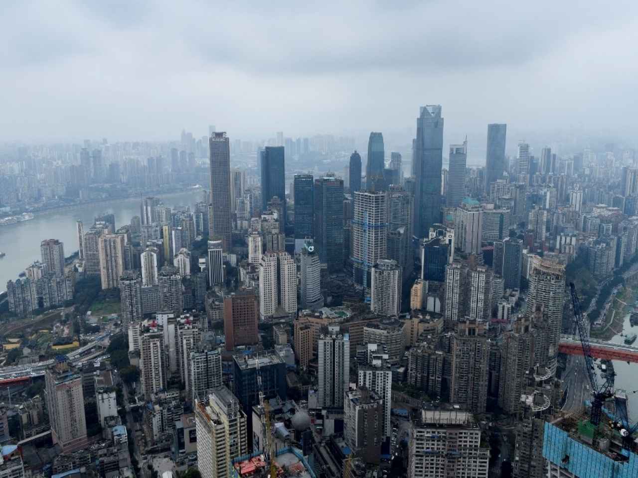 Fresh Covid-19 cases have been recorded in two more regions in the mainland, including Chongqing, a municipality that is home to more than 30 million people. File photo: AFP