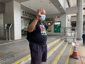 Activist fined over balloon, another to stand trial