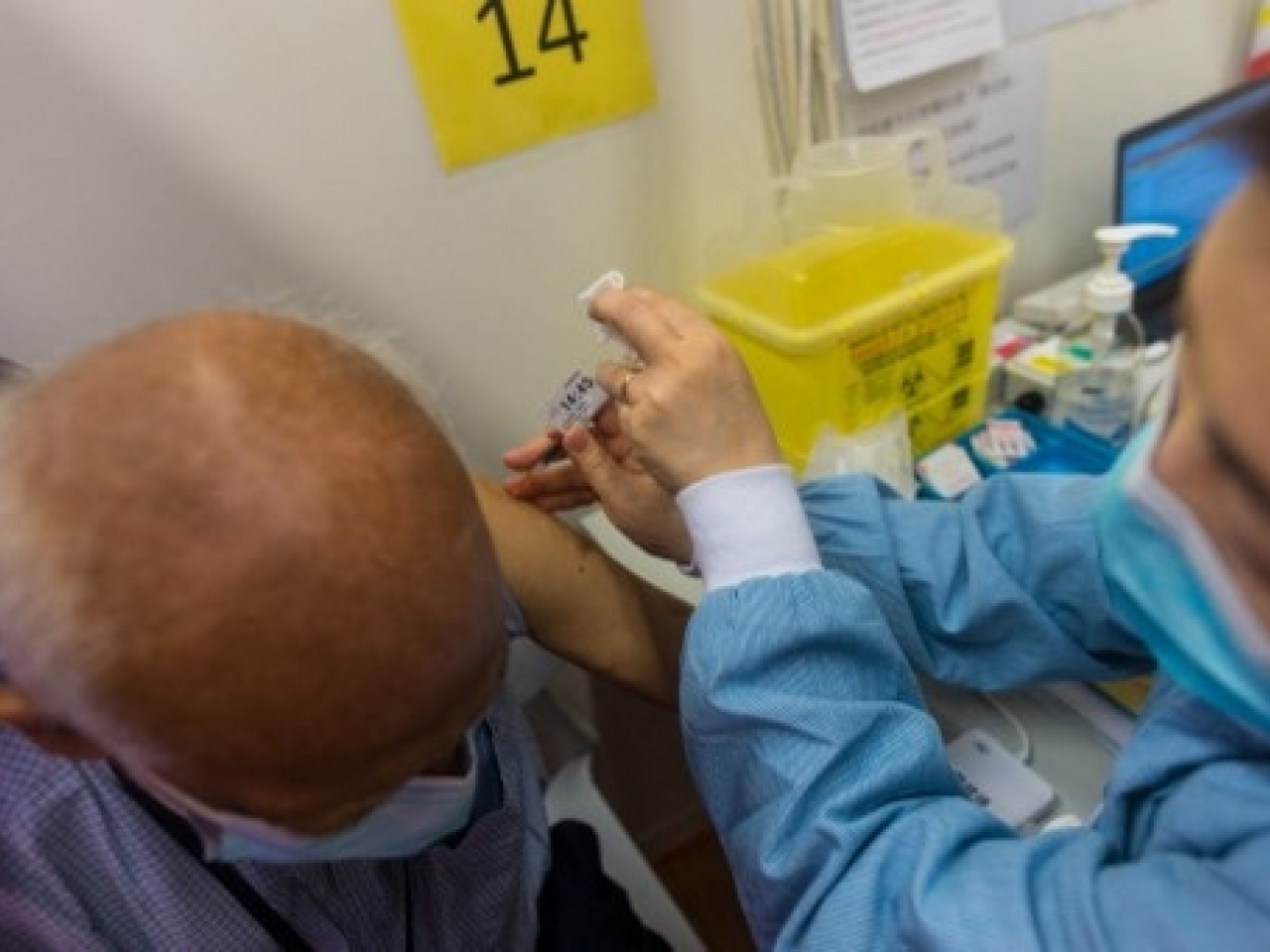 An elderly man receives his vaccination. File photo: AFP