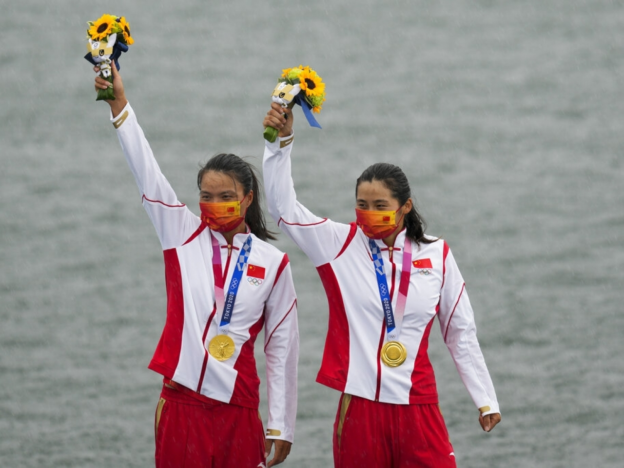Delight on the podium for China's Xu Shixiao and Sun Mengya. Photo: AP