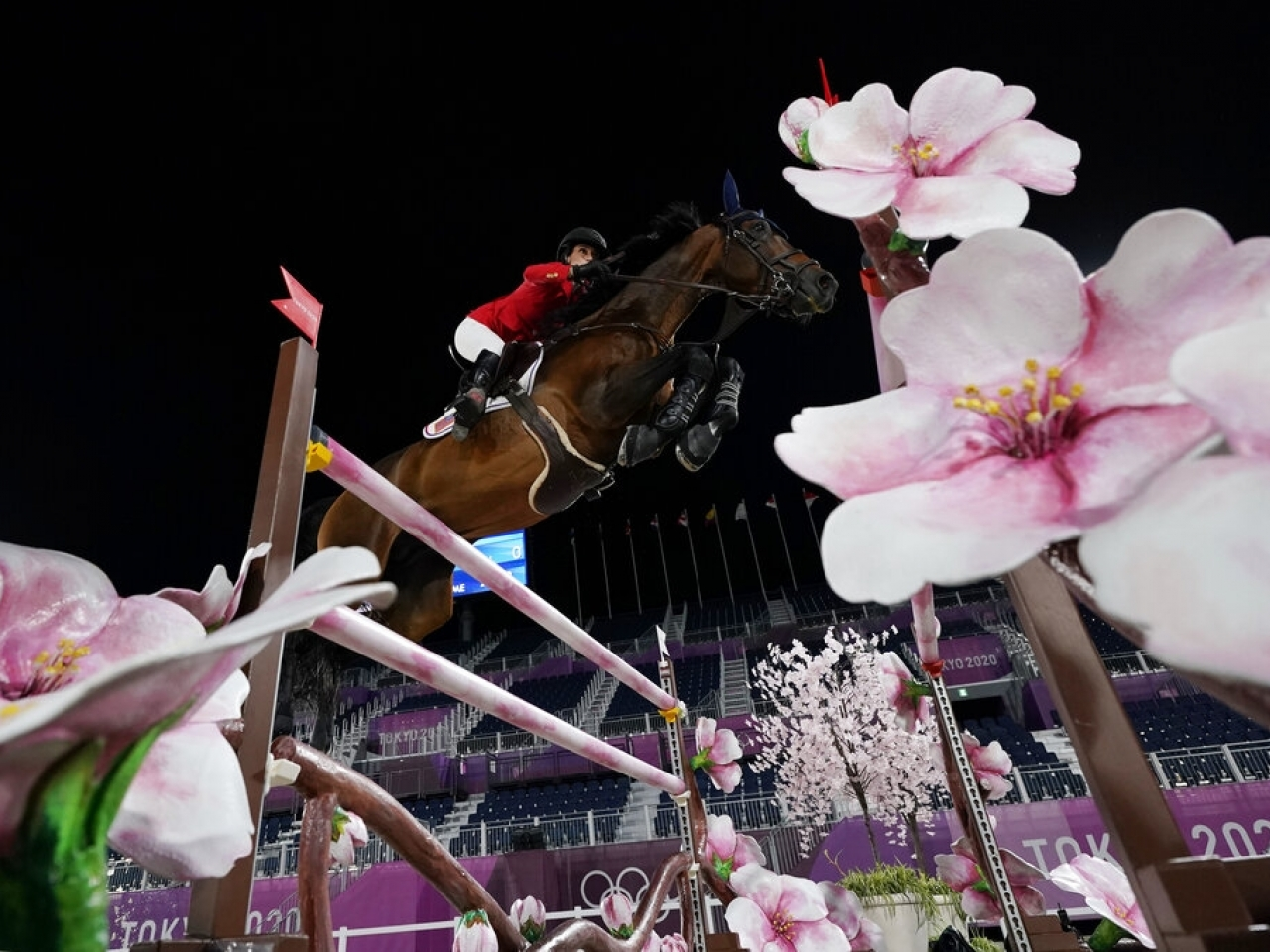 Team USA's Jessica Springsteen clears a fence in the Olympic final. Photo: AP