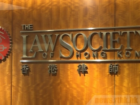 Stay professional, People's Daily warns Law Society