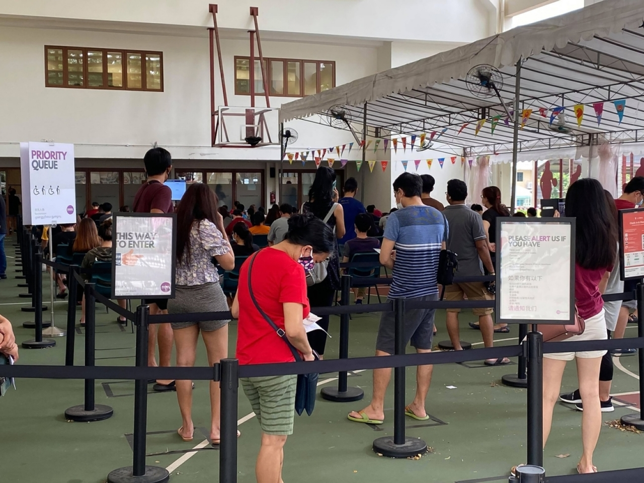 Singaporeans queue at a vaccination centre in the city-state. File image: Shutterstock