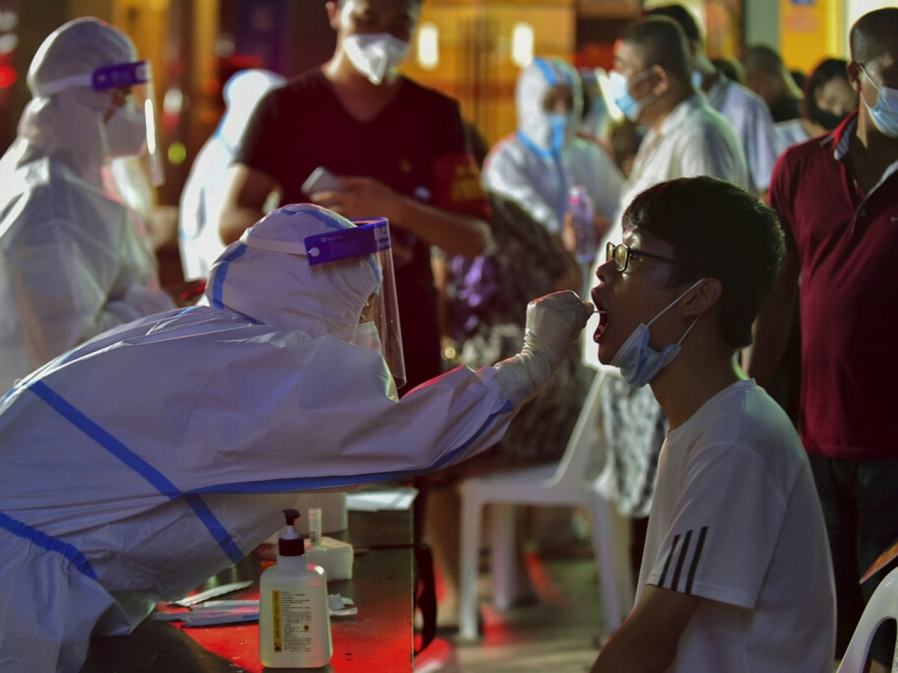 A health worker in Putian collects a swab for a Covid test. Photo: AP