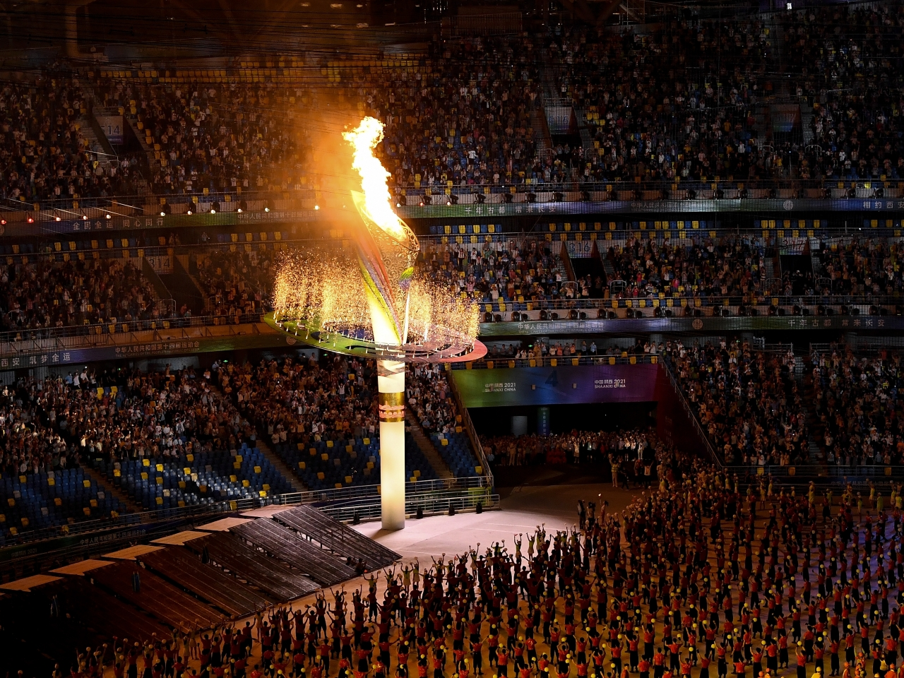 The flame is lit at the official start of the National Games in Xian. Photo: Xinhua