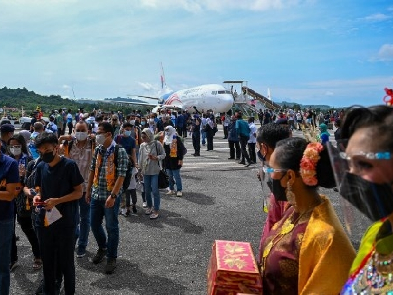 Tourists arriving at Langkawi say they're excited to be travelling again. Photo: AFP