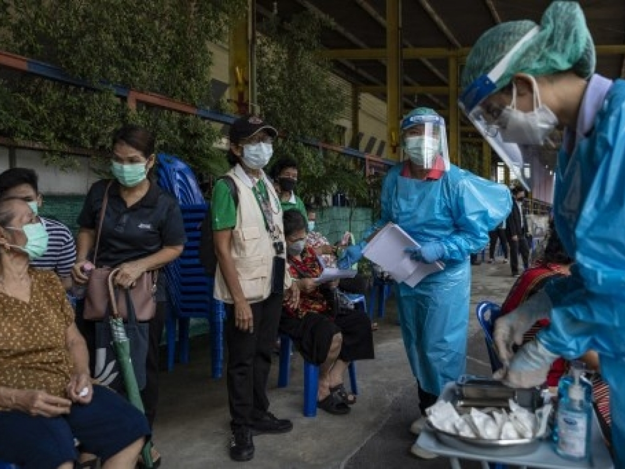 Health workers in Bangkok operate a mobile vaccination station. Only 22 percent of people in the country are fully vaccinated. File photo: AFP