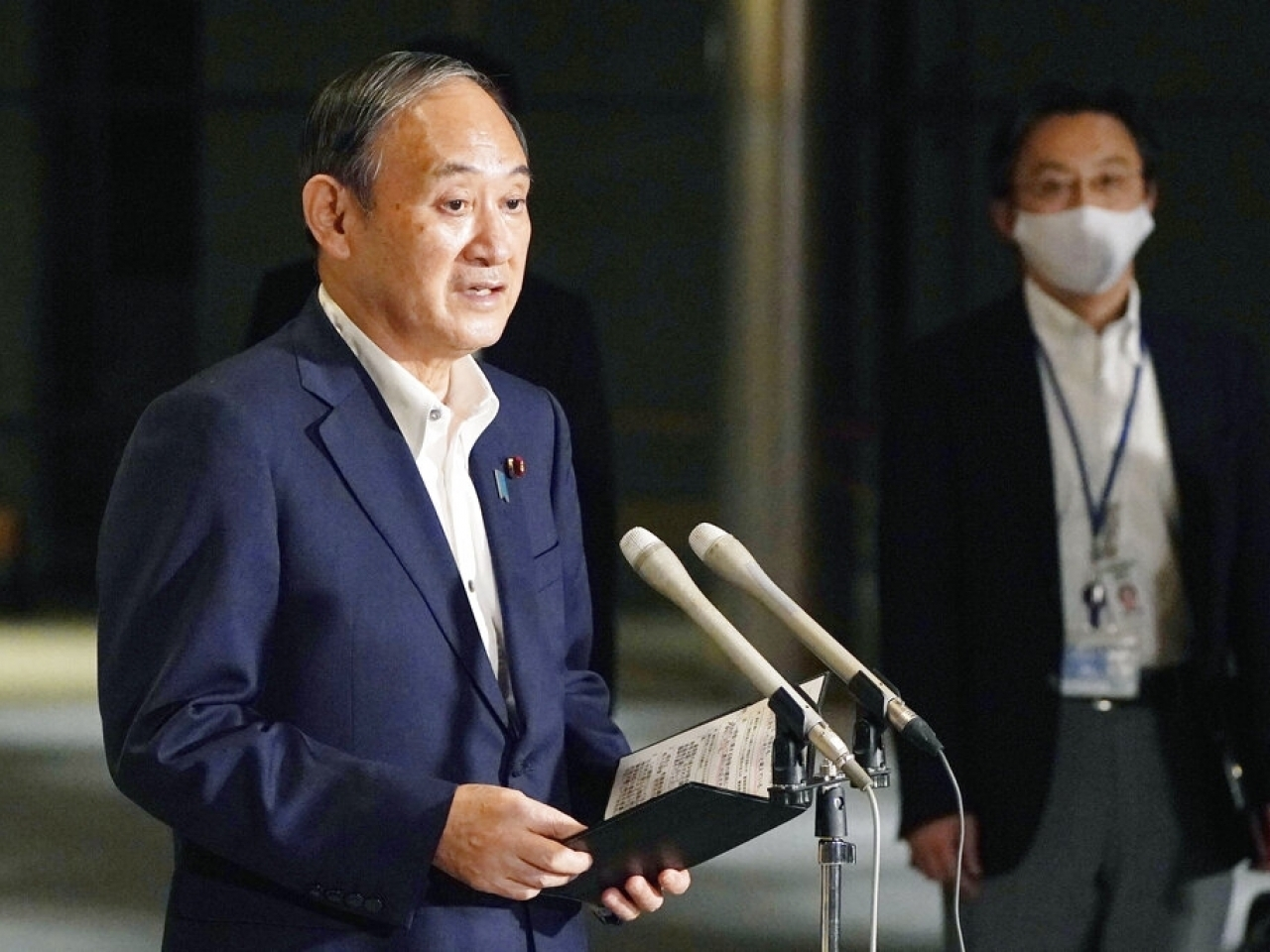 Prime Minister Yoshihide Suga is expected to announce a lifting of the emergency and subsequent plans later Tuesday. File photo: AP