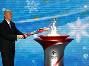 Winter Games host Beijing welcomes Olympic flame